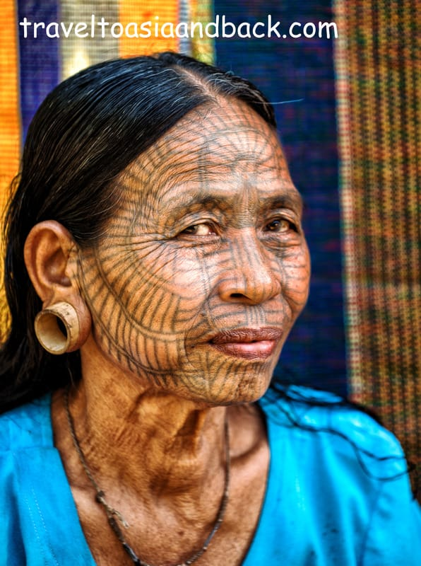 A tattooed lady from Pan Paung Village poses for a photo, Chin State, Myanmar
