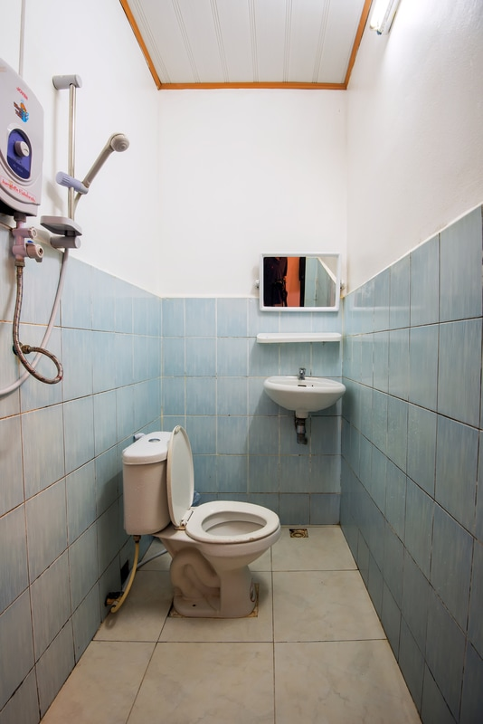 An Asian style wet bathroom in a budget hotel, Veng Vieng, Laos