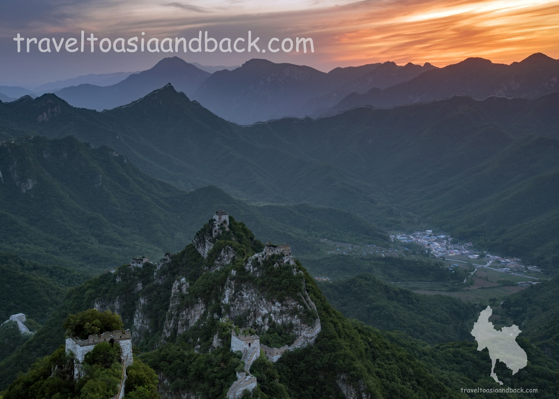 traveltoasiaandback- The sun sets behind the Jiankou Great Wall and Xizhazi village (lower right side)