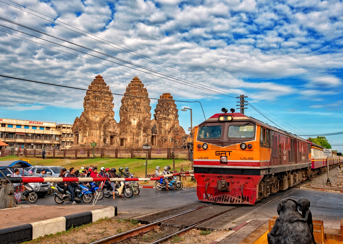 A train rolls into Lopburi Railway Station, Lopburi, Thailand
