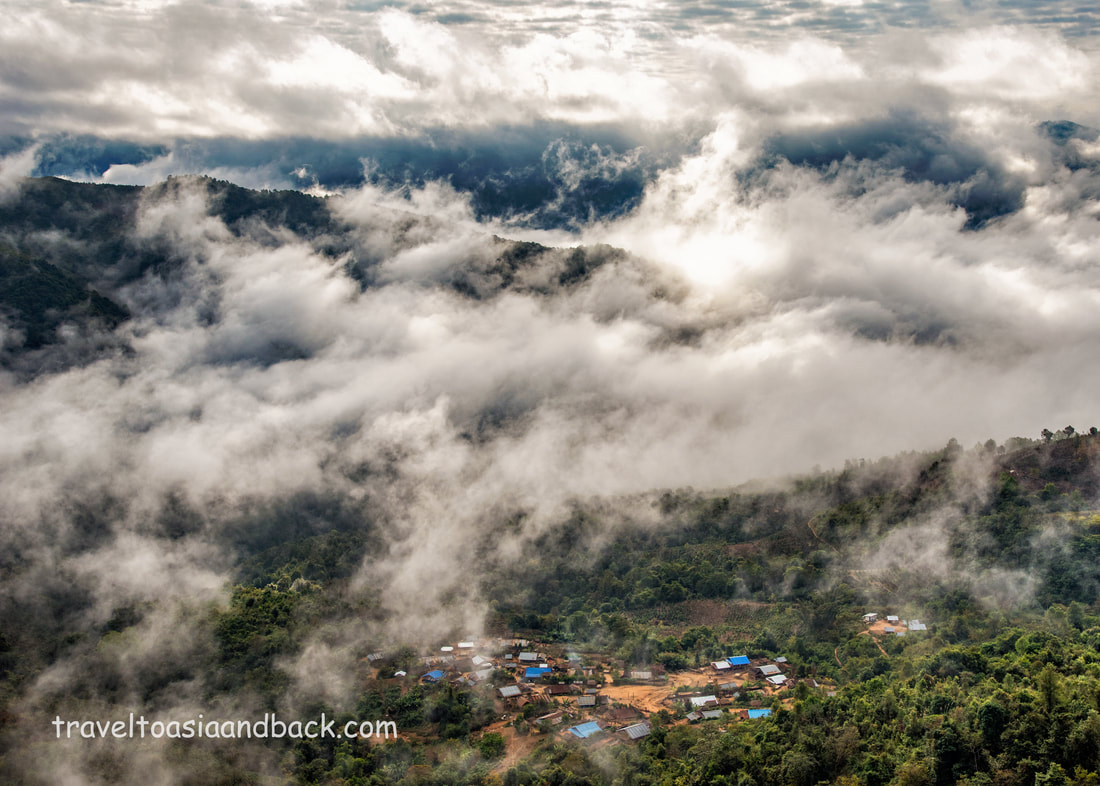 traveltoasiaandback.com - Clouds roll into the valley blanketing Namleng Village, Phongsaly Province, Laos